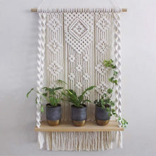 Load image into Gallery viewer, Beautiful 100 percent cotton macrame plant stand hanging in a geometric pattern.macrame