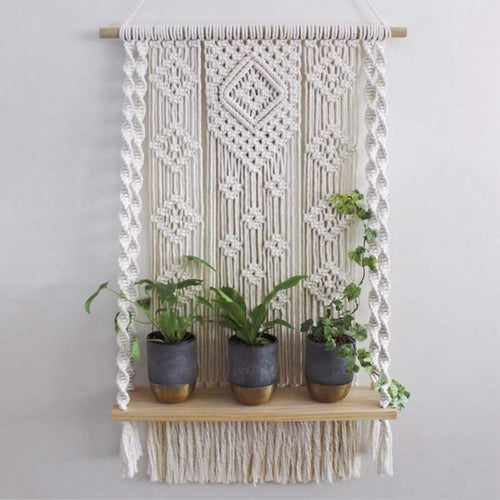 Beautiful 100 percent cotton macrame plant stand hanging in a geometric pattern.macrame