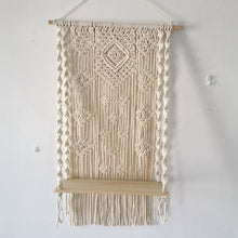 Load image into Gallery viewer, Beautiful 100 percent cotton macrame plant stand hanging in a geometric pattern.