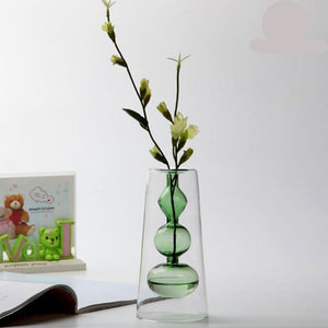 Modern glass vases add a clean contemporary esthetic