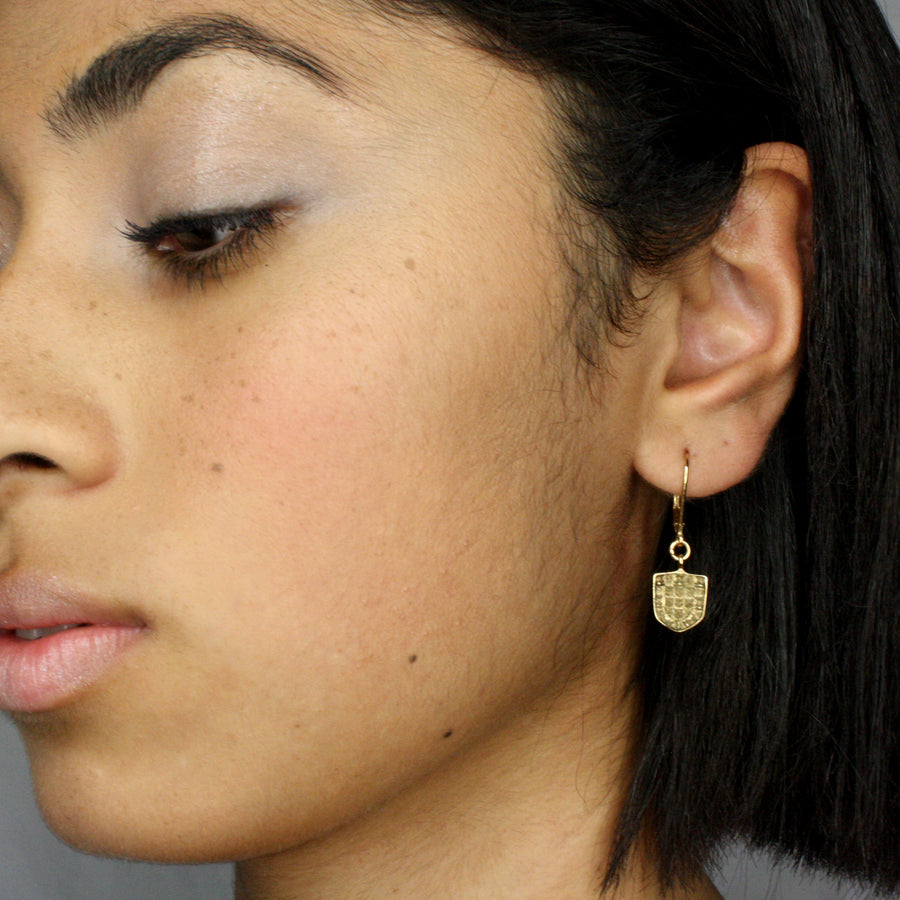 Protection shield drop earring plated.