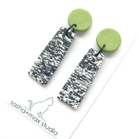 Pixelated black white and green drop statement earrings
