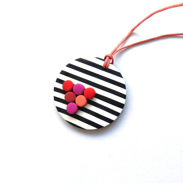 black and white pendant with pops of pink, red and coral