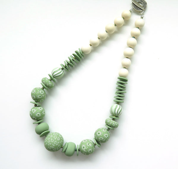 Green swirls polymer clay necklace