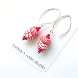 Big Swirl red coral white beaded drop earrings