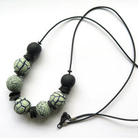 Chunky modern pale green and black necklace