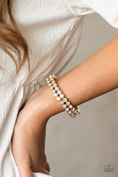 Paparazzi Come and Get It! - Gold Rhinestone Bracelet - A Finishing Touch