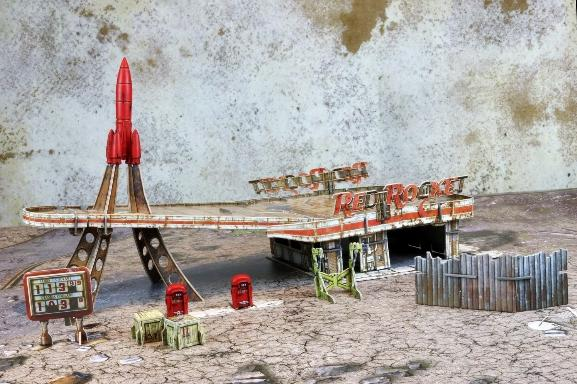 Fallout: Wasteland Warfare – Terrain Expansion:  Red Rocket Gas Station (No Mat) - Modiphius Entertainment
