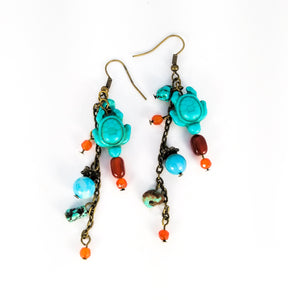 CD0191  Handmade Earrings with Turquoise Blue Howelite Turtles and finished off with Carnelian Beads
