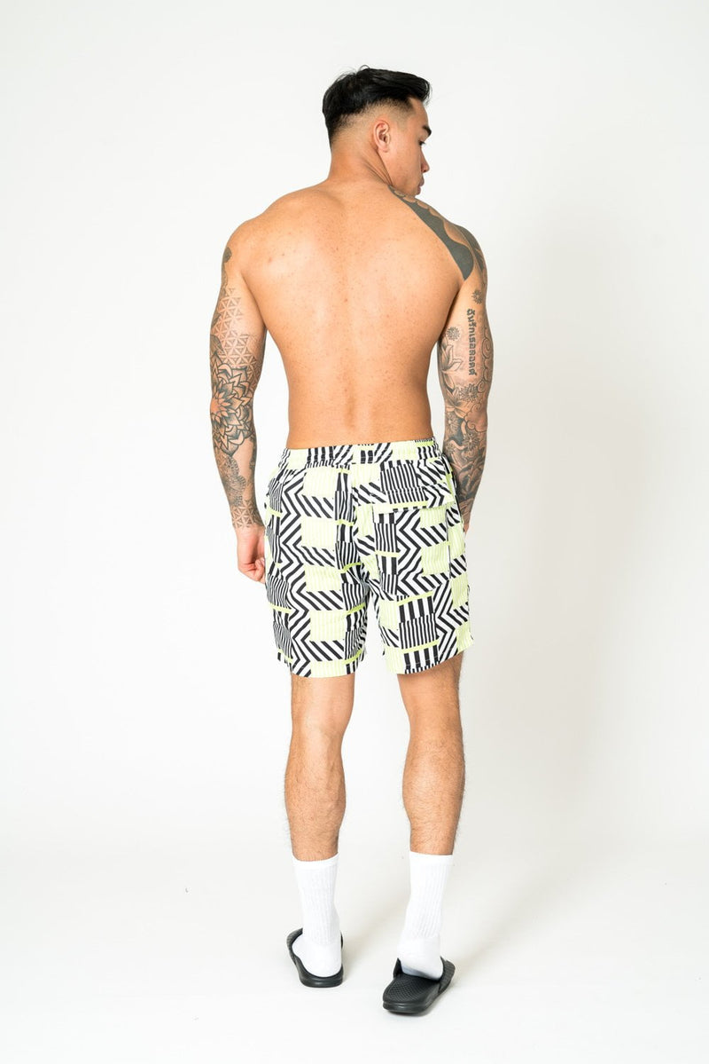 RELAXED FIT SHORTS IN LIME BLACK WITH GEO STRIPE