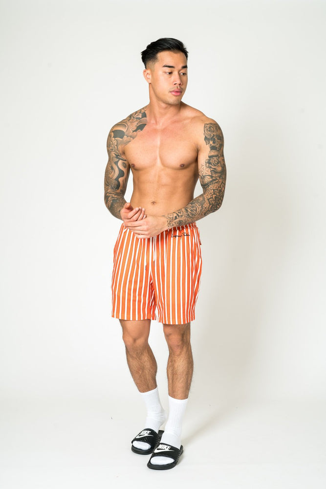 RELAXED FIT SHORTS IN RUST & WHITE