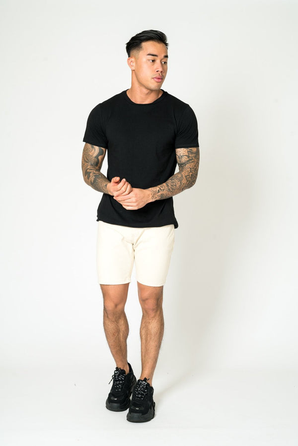 MIAMI RELAXED DENIM SHORTS IN ECRU