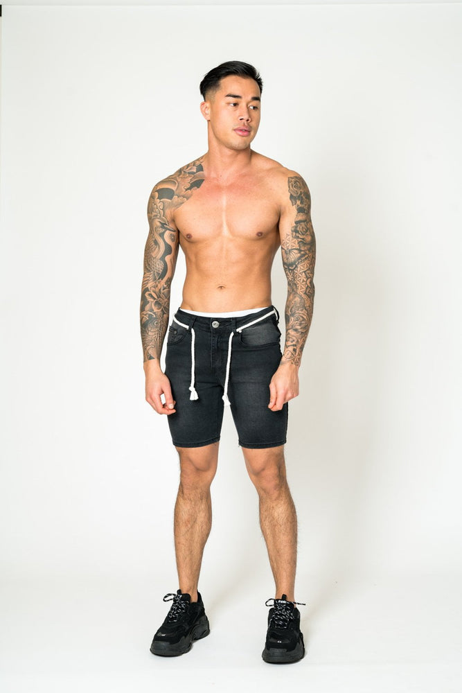 DENIM SHORTS IN WASHED BLACK WITH ROPE TIE AND SIDE FADE