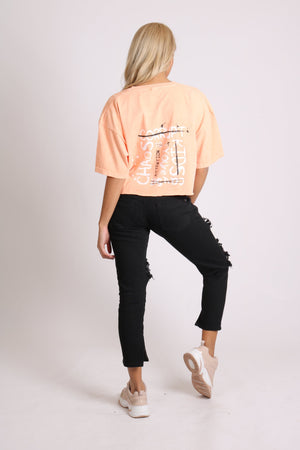 Cropped t shirt in peach with corrupt print