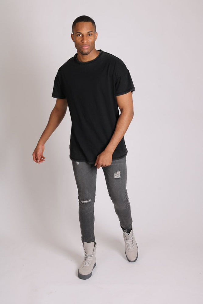 Logan stretch skinny jeans in washed black with distressing