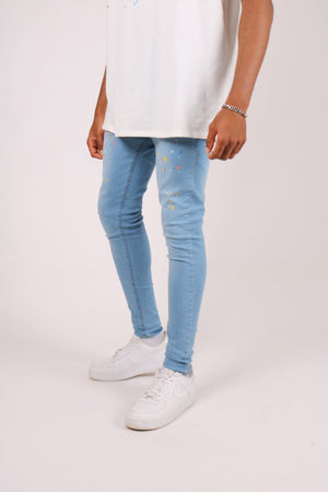 Load image into Gallery viewer, Logan skinny jeans in stonewash indigo with paint splatter - Liquor N Poker  LIQUOR N POKER