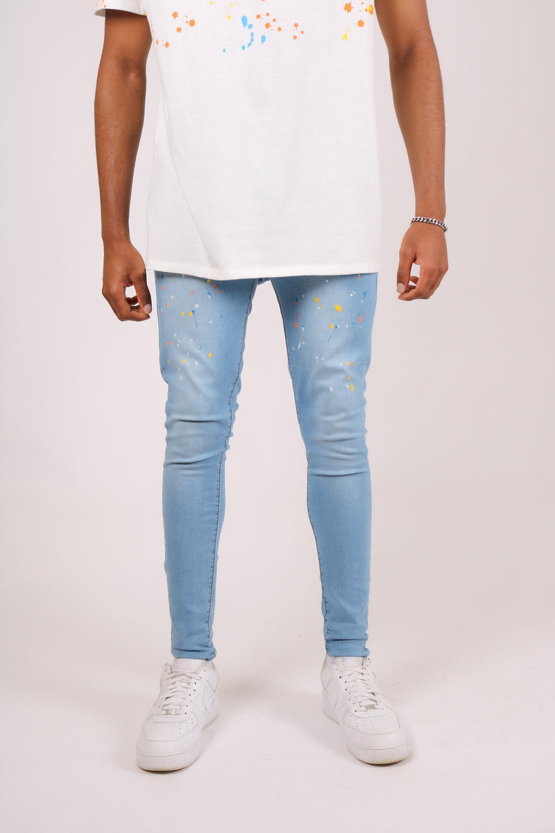 Logan skinny jeans in stonewash indigo with paint splatter - Liquor N Poker  Liquor N Poker