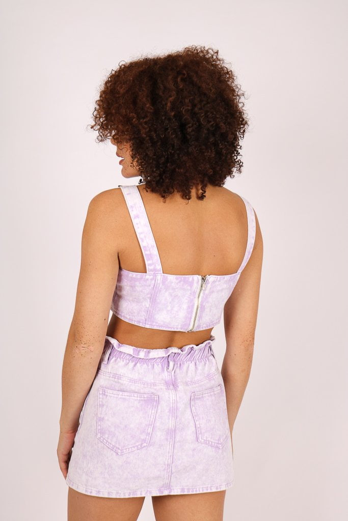 Outta Limits denim mini skirt in lilac acid wash