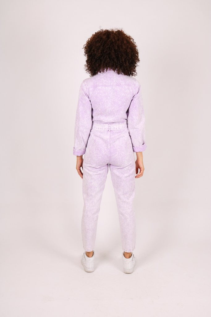 Outta limits denim jumpsuit in lilac acid wash