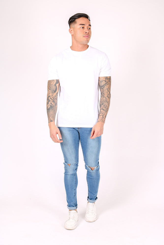 Logan Skinny Stretch Jeans In Light Stonewash With Ripped Knee - Liquor N Poker  LIQUOR N POKER