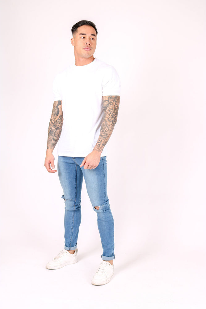 Logan Skinny Stretch Jeans In Light Stonewash With Ripped Knee