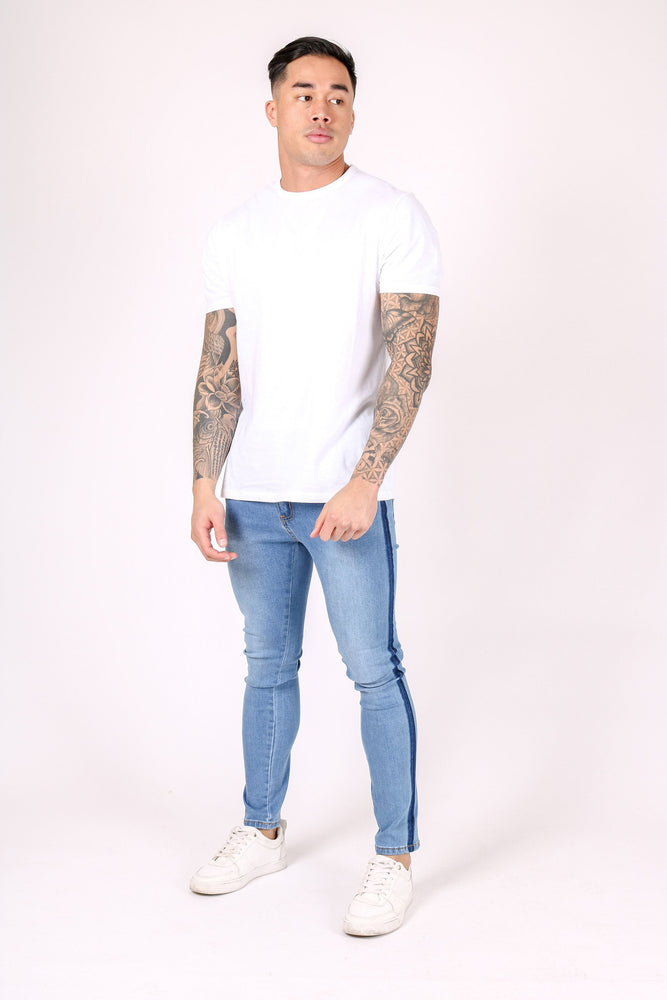 LOGAN SKINNY JEANS WITH PINCH FADE DETAIL  Premium stretch denim 98% cotton / 2% elastane Super stretch Our best selling skinny fit Tapered to the body Pinch fade detailing Our model wears UK30 - Liquor N Poker  Liquor N Poker