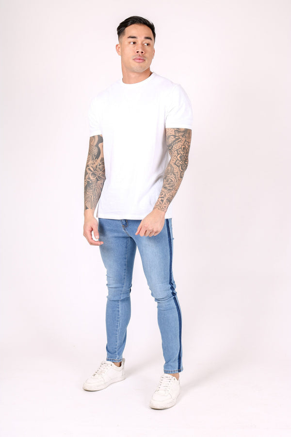 LOGAN BLUE SKINNY JEANS WITH PINCH FADE DETAIL - Liquor N Poker  Liquor N Poker