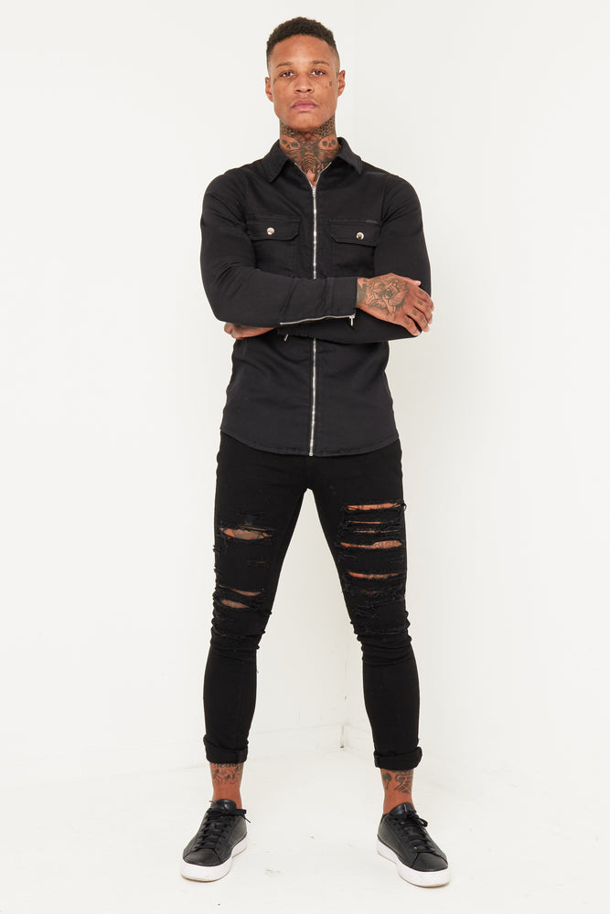 Logan skinny jeans with all over distressing in black