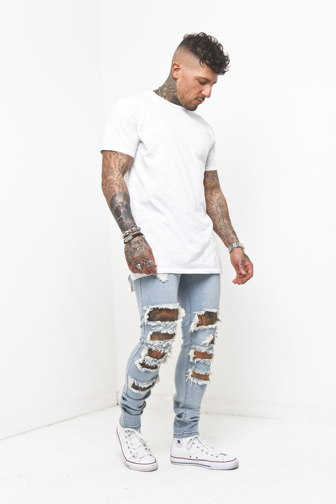 Logan Skinny Stretch Jeans With Super Distressing - Liquor N Poker  Liquor N Poker