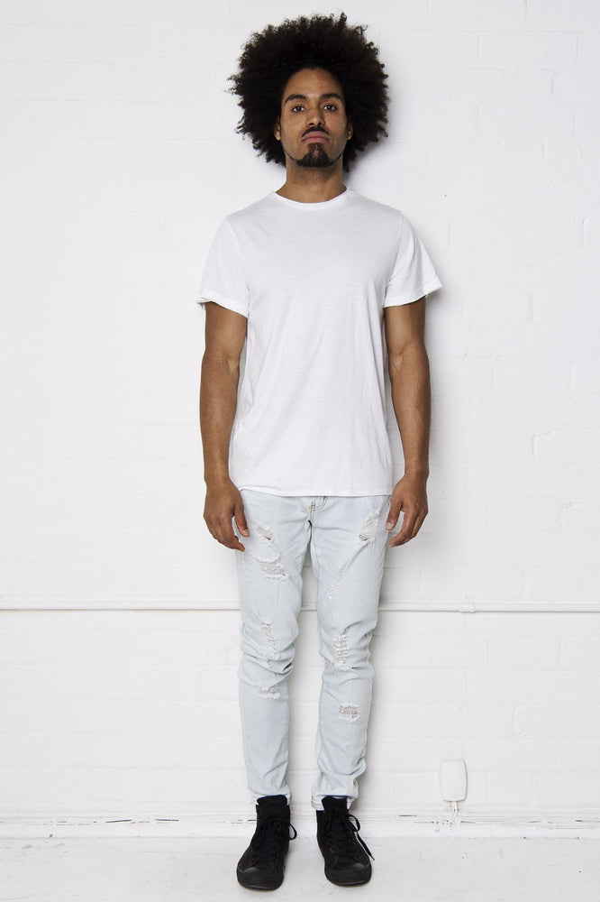 Faro Slim Jean In Bleached Stonewash With All Over Distressing