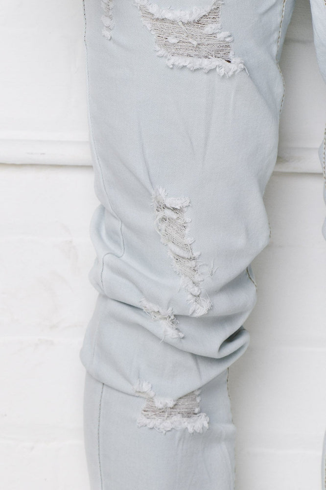 Faro Slim Jean In Bleached Stonewash With All Over Distressing - Liquor N Poker  LIQUOR N POKER