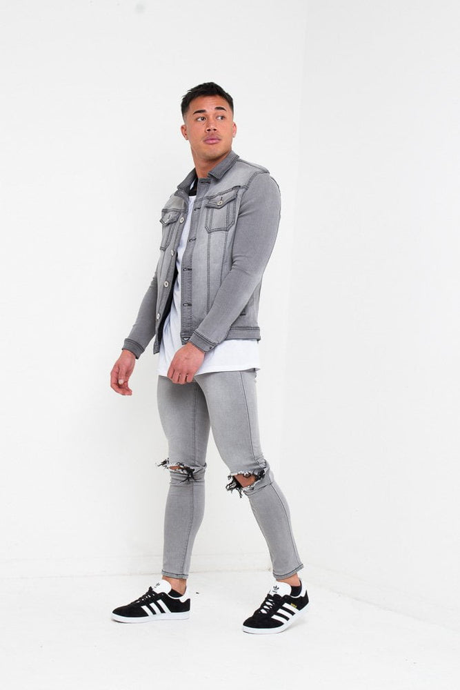 LOGAN SKINNY JEANS WITH RIPPED KNEE IN WASHED GREY