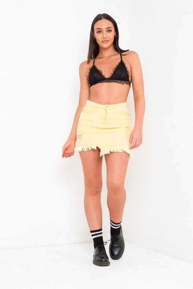 DAKOTA MINI DISTRESSED DENIM SKIRT IN LEMON