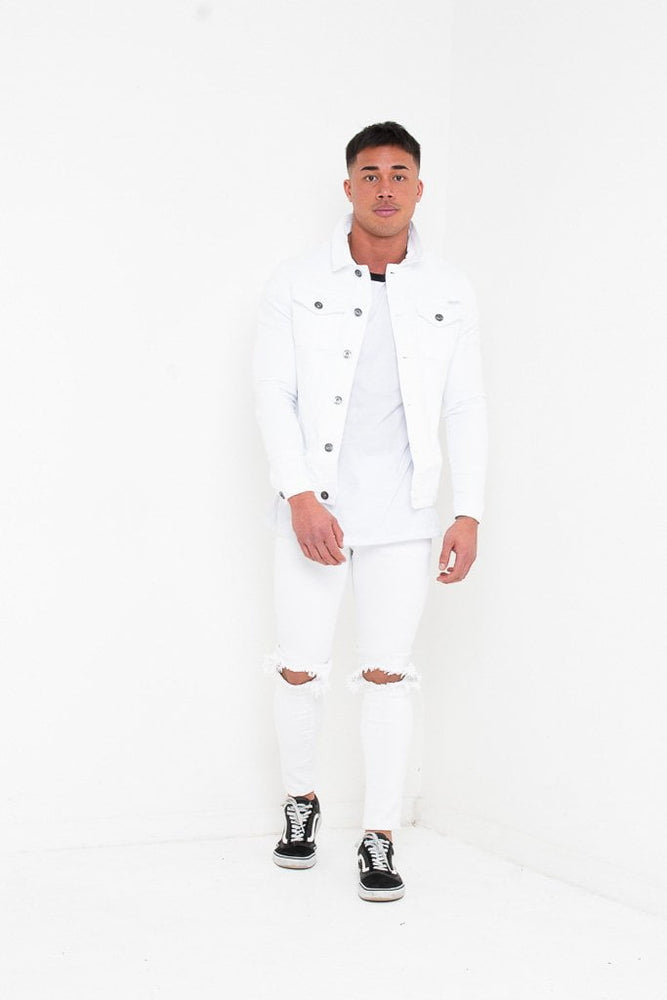 LOGAN SKINNY JEANS WITH RIPPED KNEE IN WASHED WHITE
