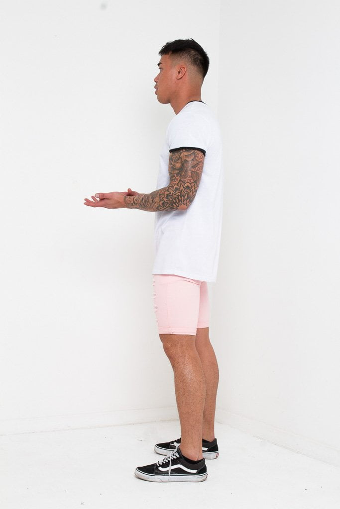 SKINNY FIT STRETCH DENIM SHORTS WITH RIPS IN PINK