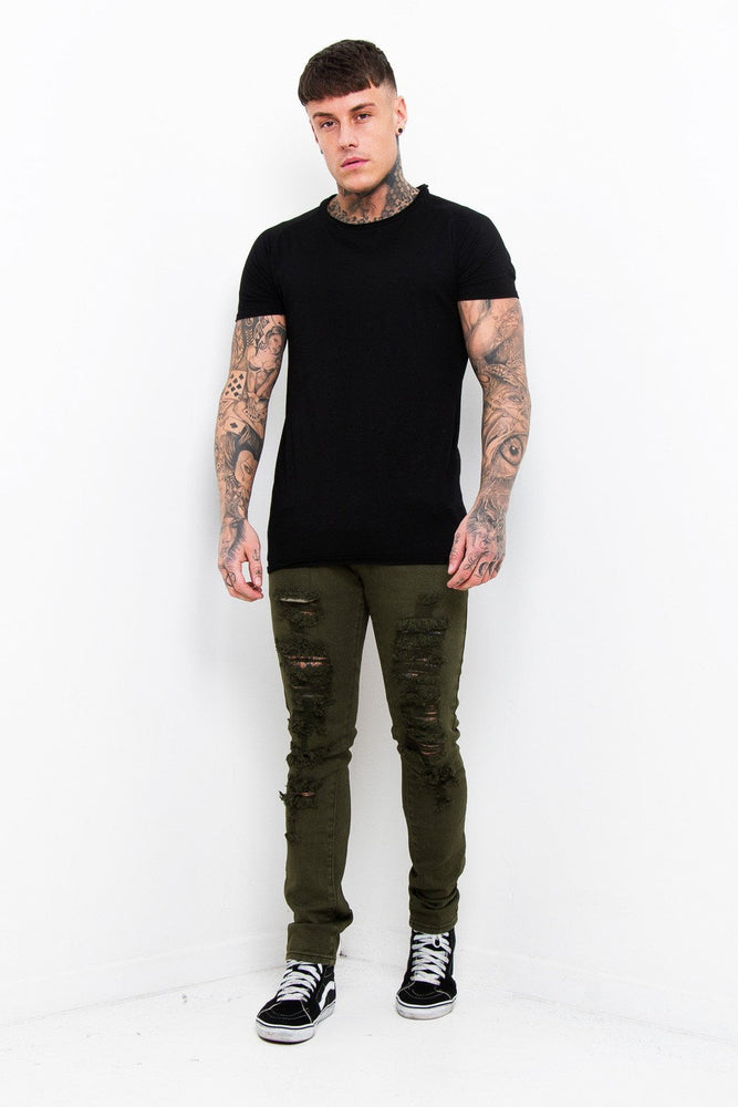 Faro Slim Jeans In Khaki With All Over Distressing And Rip