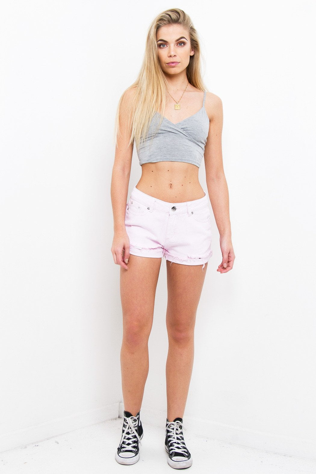 Topeka Mid Rise Shorts With Raw Hem In Pink