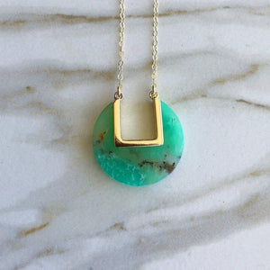 "Green chrysoprase coin necklace with gold ""u"" shaped cut out"