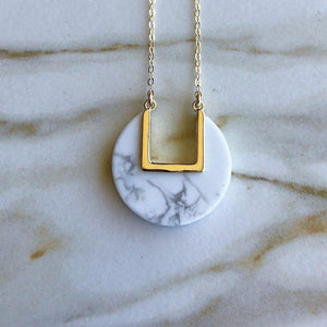 "Marbled white howlite circular stone necklace with ""u"" shaped cutout"