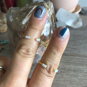 Small open gold twist ring with mini opal bar stones
