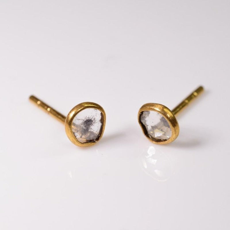 Beautiful mirror-like round diamond studs set flush in gold
