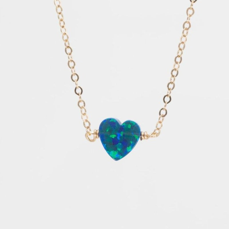 Small blue opal heart on gold necklace