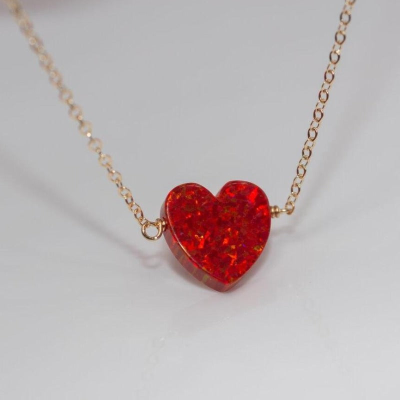 Red heart opal necklace on thin gold chain