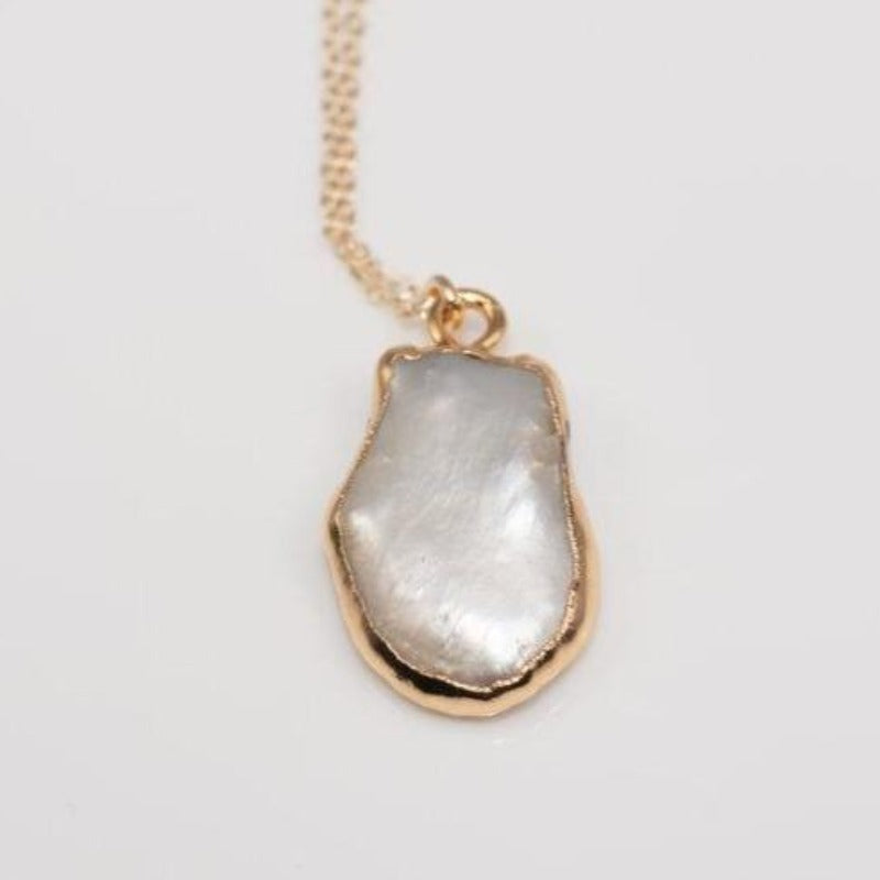 Natural cut white pearl pendant on delicate gold chain