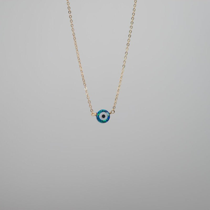 Tiny blue opal evil eye on dainty gold chain