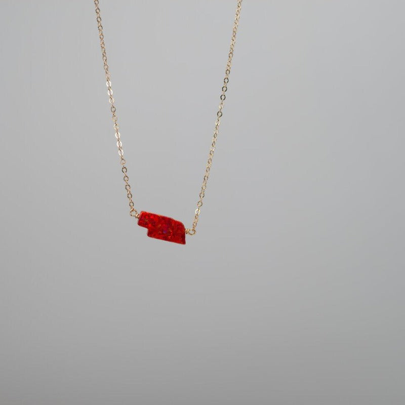 Dainty gold necklace with Red Nebraska state charm in opal