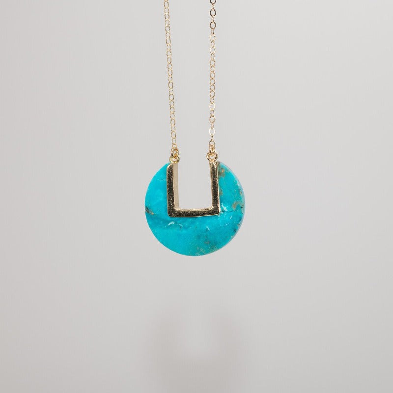 Turquoise coin-shaped pendant on dainty gold chain