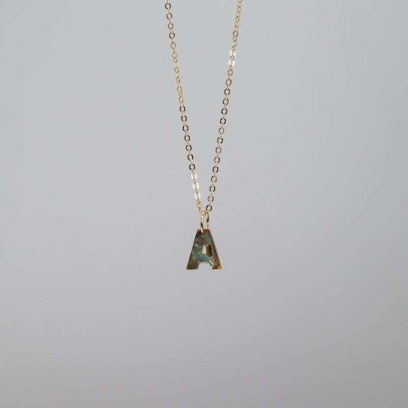 "Abalone ""A"" charm on a gold chain"