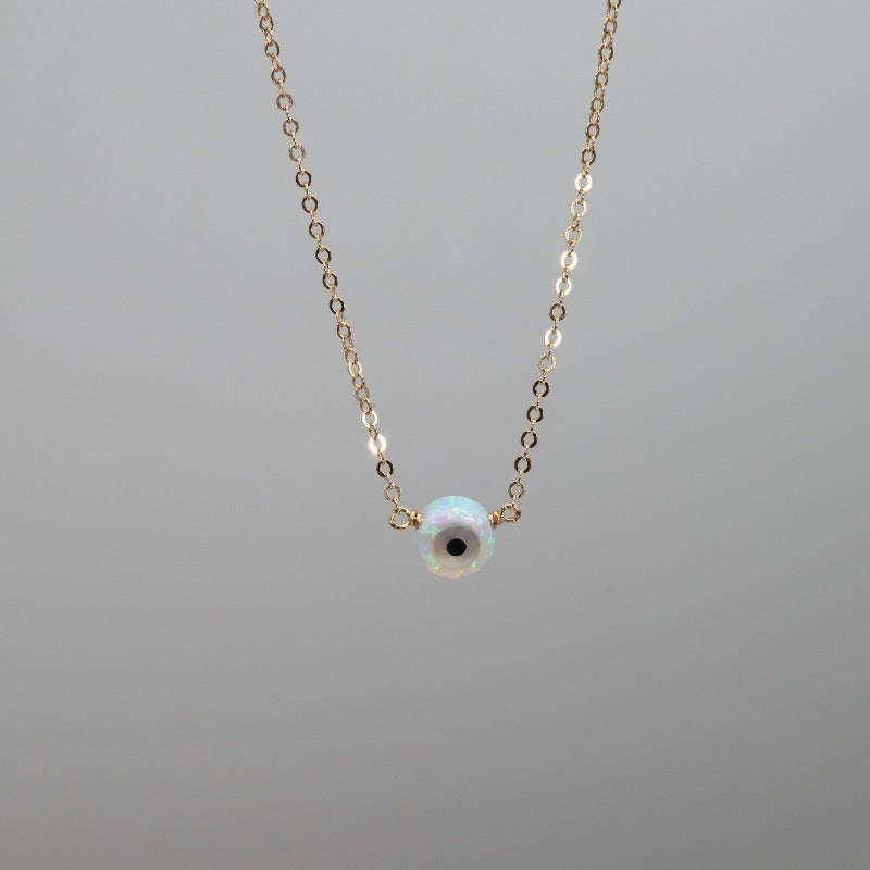 Small white opal evil eye necklace pendant