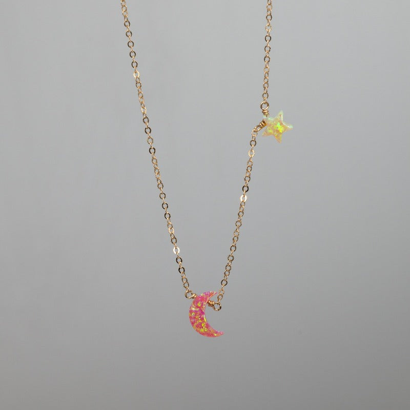 Pink crescent moon charm necklace with yellow star in opal and gold